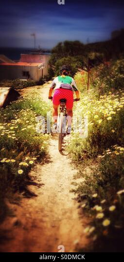 Woman doing Mountain Bike - Stock Image