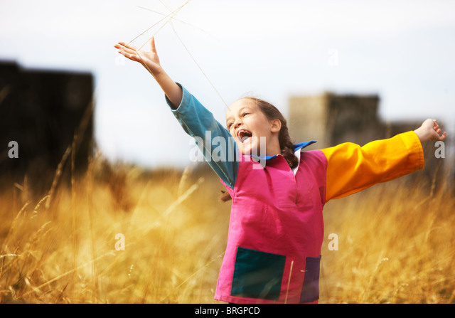 Happy child in a meadow - Stock Image