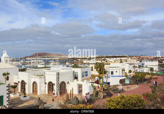 White buildings in new modern upmarket development of Marina Rubicon, Playa Blanca, Lanzarote, Canary Islands, Spain - Stock Image