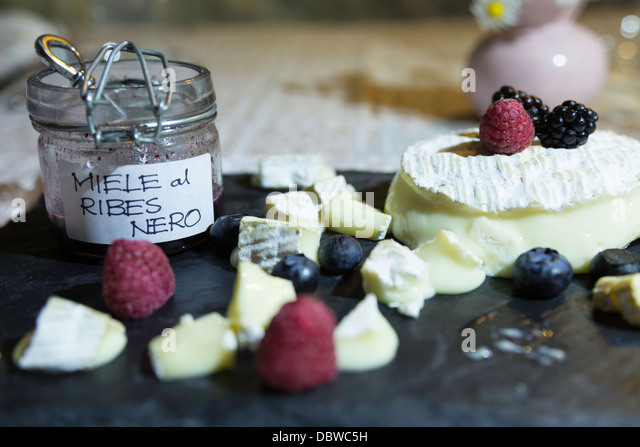 Italian cheese with fruits and marmalade - Stock Image