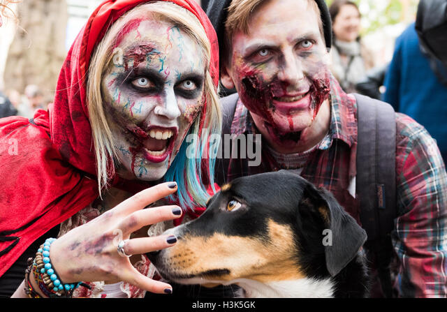 London, UK, 8 October 2016. Zombies in Central London celebrating World Zombie Day while raising funds for St Mungo's - Stock Image