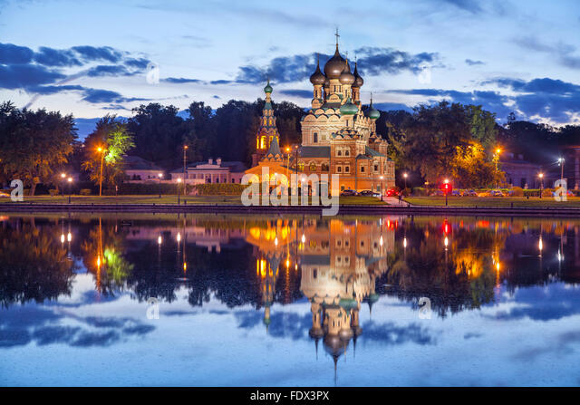 Trinity church reflecting in Ostankino pond in the evening, Moscow, Russia - Stock Image