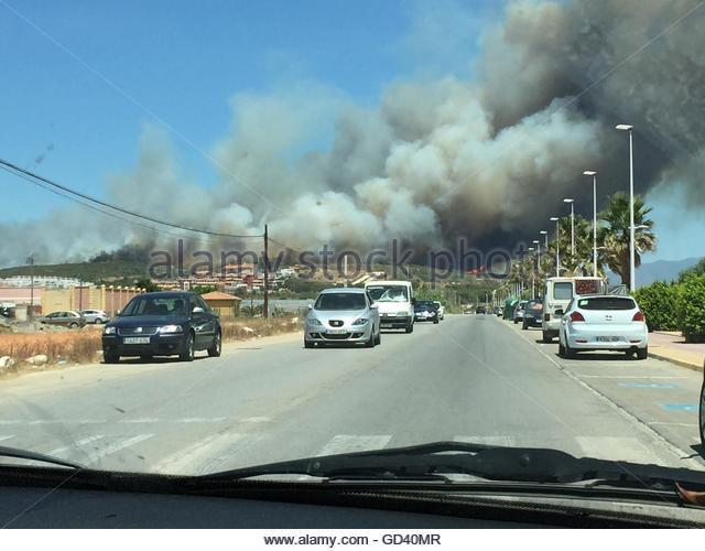 La Linea De La Concepcion, Spain. 12th July, 2016. A wildfire erupts on July 12, 2016 at La Linea de la Concepcion, - Stock Image
