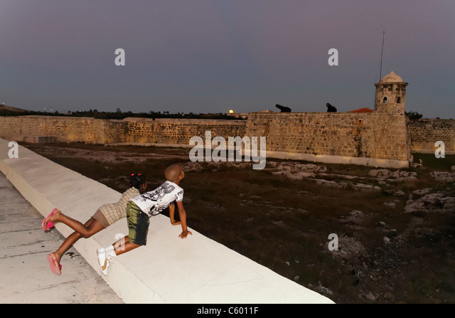 Havanna Cuba, Castillo de San Salvador de la Punta at twilight , kids - Stock Image