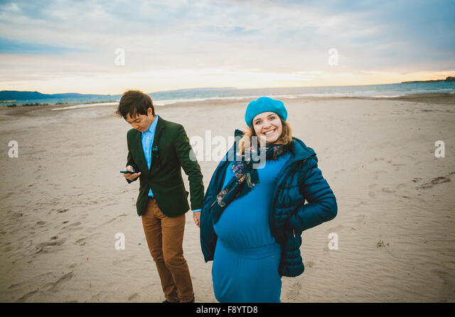 pregnant woman  walking outdoor in warm day - Stock-Bilder