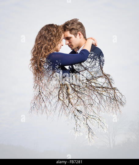Double exposure of beautiful young couple - Stock Image