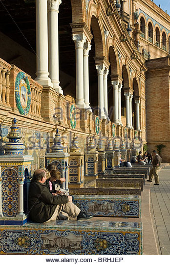 People sitting at the 1929 Exposition Building in Plaza de Espana. - Stock Image