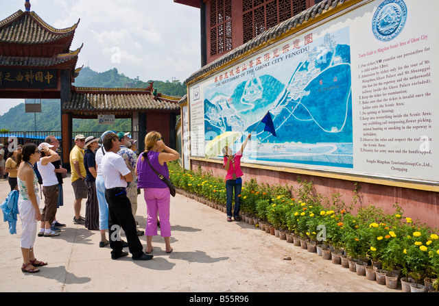Tourists and guide at the large map at the entrance to Ghost City Fengdu on the Yangzi River China JMH3350 - Stock Image