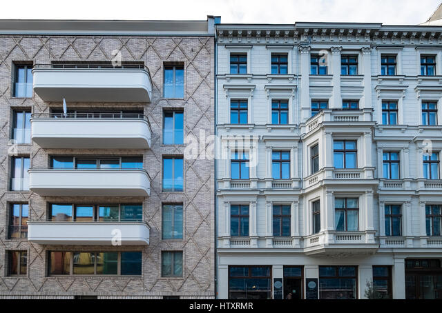 Contrast between modern apartment building and traditional building in gentrified district of Prenzlauer Berg, Berlin, - Stock Image