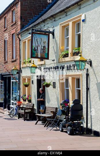 Man standing in doorway of the Shoulder of Mutton Pub, Brampton, Cumbria, England UK - Stock Image