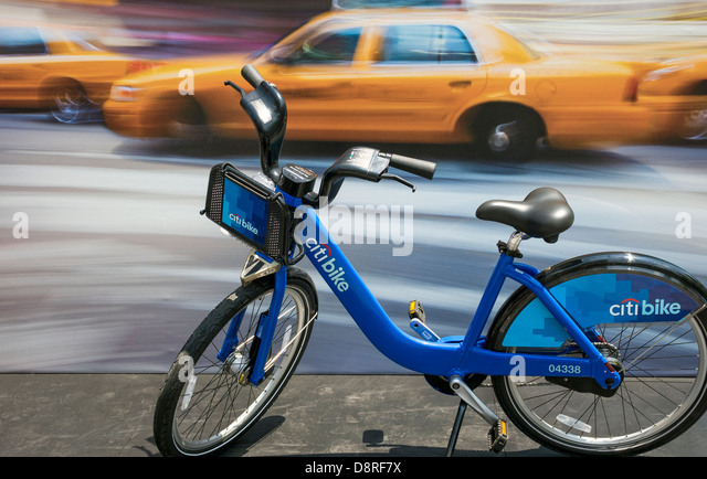 A NYC Citi Bike is contrasted against yellow taxis as local transportation Stock Photo
