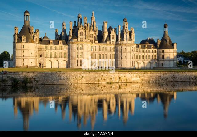 Sunset over the massive, 440 room, Chateau de Chambord, Loire-et-Cher, France - Stock Image