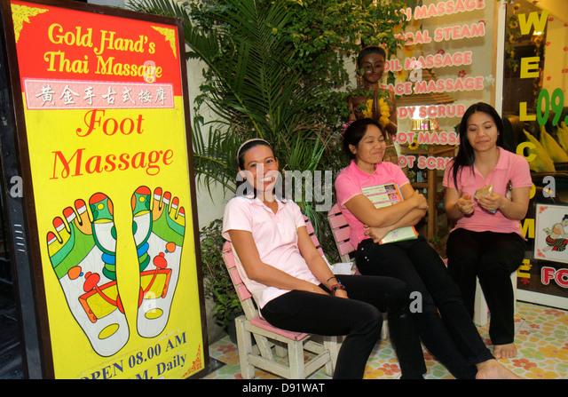 Bangkok Thailand Pathum Wan Rama 1 Road Asian woman Thai massage foot parlor sign advertising - Stock Image
