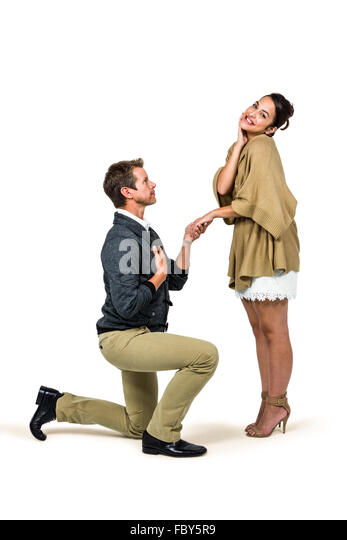 Kneeling Down While Pregnant Man Proposing On...