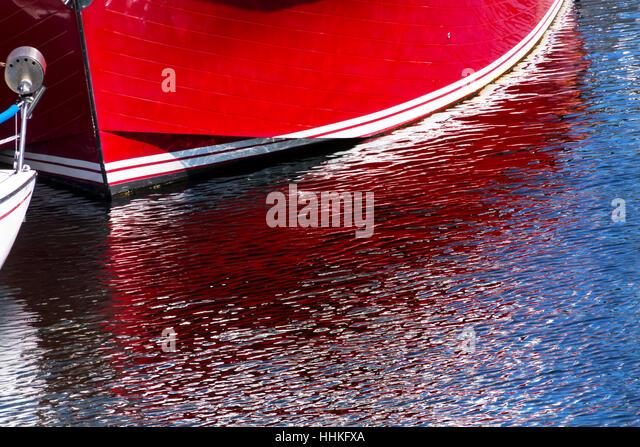 reflection, abstract, boat, red, rowing boat, sailing boat, sailboat, - Stock Image