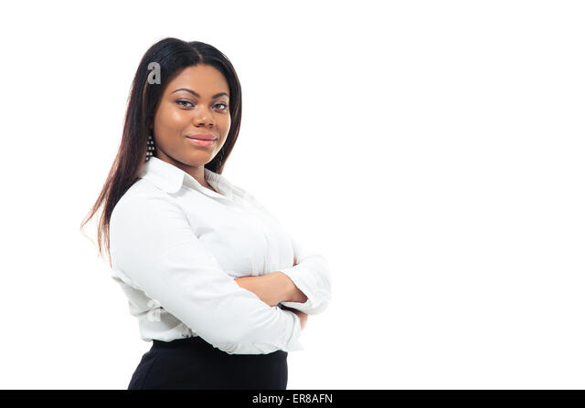 Happy afro american businesswoman standing with arms folded - Stock Image