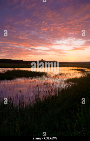 Sunset reflected in Bunduff Lough, Mullaghmore, County Sligo, Ireland. - Stock-Bilder