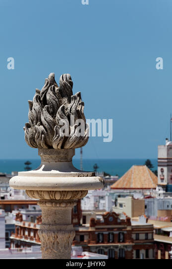 Sculpture of burning torch, Cadiz Cathedral (Catedral de Santa Cruz de Cádiz), Plaza Catedral, Cadiz, Spain - Stock Image