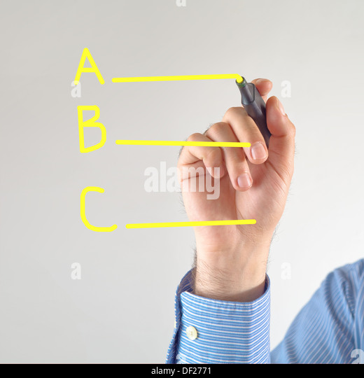 Different options. Businessman writing with yellow marker pen on the screen - Stock Image