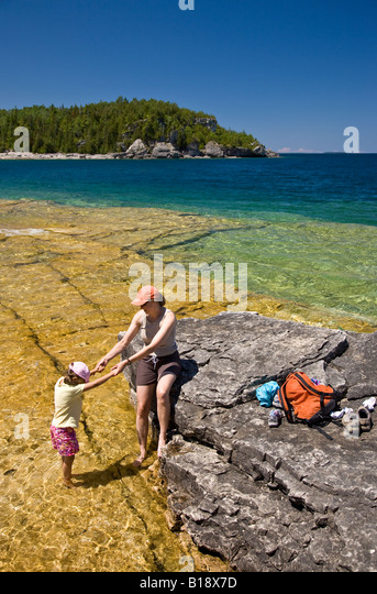 Young woman with daughter on Niagara Escarpment near Boulder Beach along Bruce Trail, Bruce Penninsula National - Stock Image
