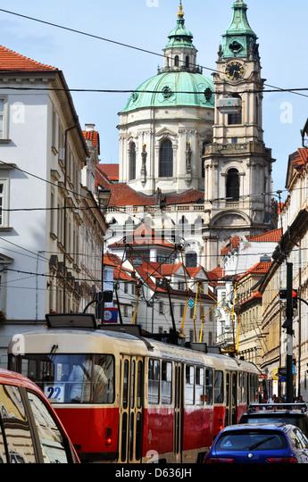 Trams on the Mala Strana , Prague, Czech Republic , Malostranské Náměstí with the Church of Saint - Stock Image