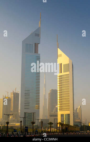 UAE, Dubai, Sheikh Zayed Road, Emirates Towers and Burj Khalifa beyond - Stock-Bilder