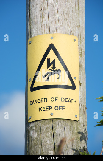 A 'Danger of death' warning on a wooden pole supporting electrical cables. UK, 2013. - Stock Image