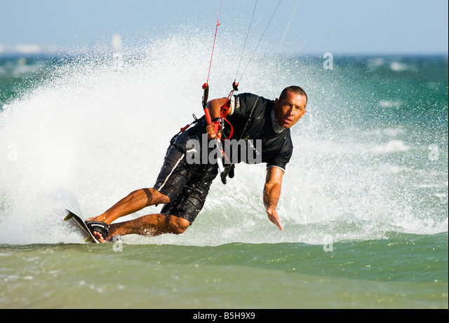 kitesurfing carving the sea - Stock Image