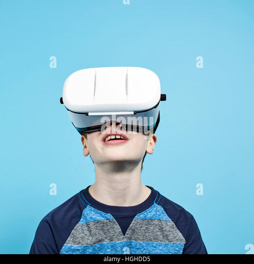 boy 10yo wearing VR headset, VR Glasses - Stock Image