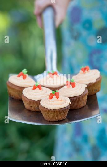 Carrot cupcakes on garden spade selective focus - Stock-Bilder