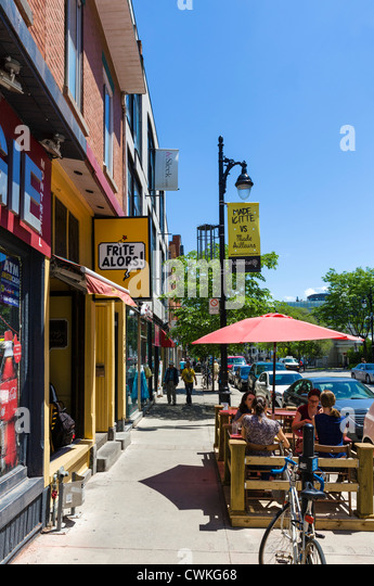 Shops and cafes on Boulevard Saint-Laurent in the Plateau Mont-Royal district north of Rue Sherbrook, Montreal, - Stock Image