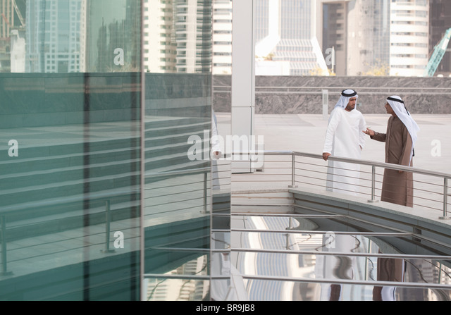 Middle eastern businessmen by office building - Stock-Bilder