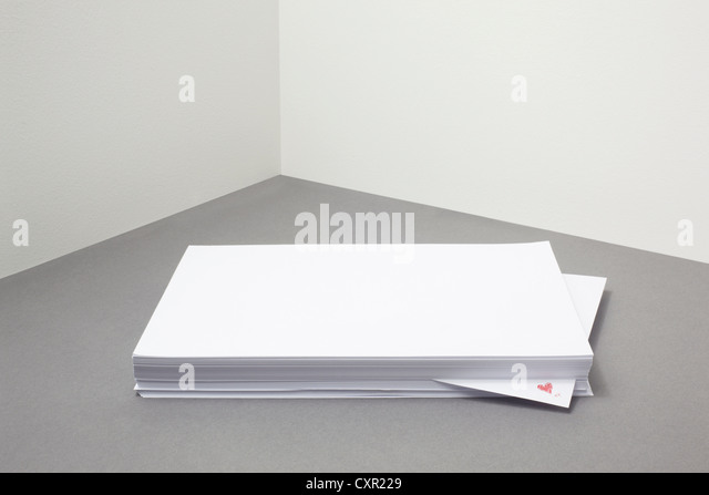 Stack of blank paper with heart shape on one piece - Stock Image