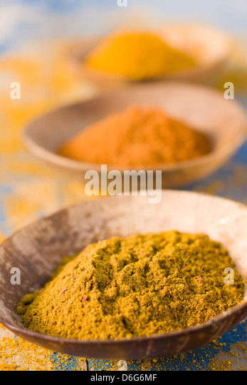 Curry powder in bowls - Stock Image