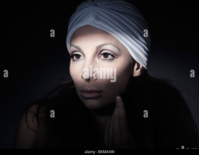 Light falling on a beautiful woman face artistic portrait - Stock Image