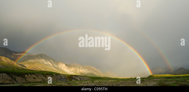 A double rainbow over the Hulahula River at Grasser's Strip in Alaska's Arctic National Wildlife Refuge - Stock Image