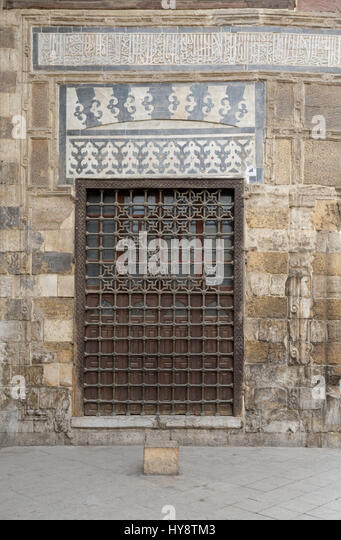 Wooden window with decorated iron grid over stone bricks wall at Madrasa and Mausoleum of As-Saleh Nagm Ad-Din Ayyub, - Stock Image