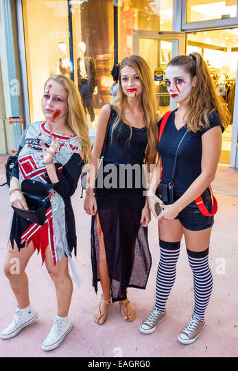 Miami Beach Florida Lincoln Road pedestrian mall Halloween costume wearing outfit character teen girl zombie cheerleader - Stock Image