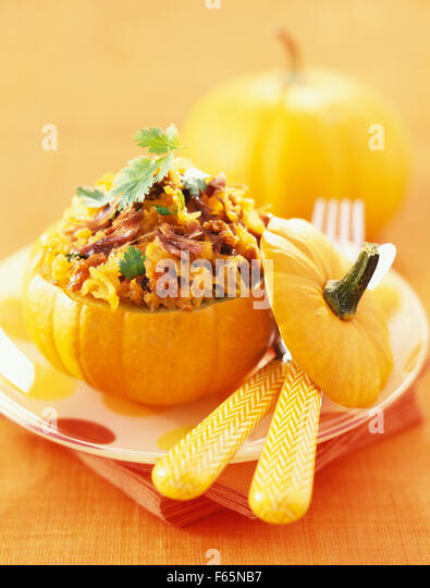 baby pumpkin stuffed with duck confit - Stock Image
