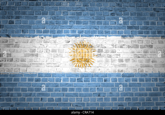 An image of the Argentina flag painted on a brick wall in an urban location - Stock Image