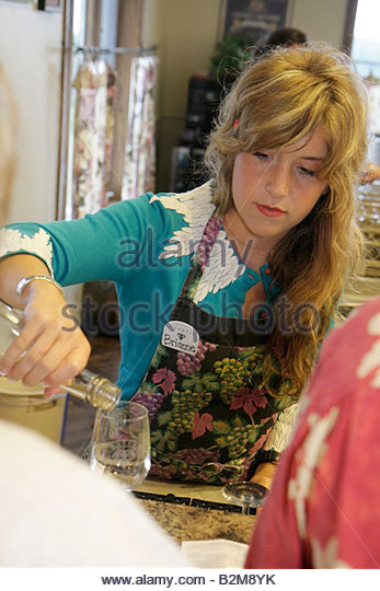Michigan Traverse City Old Mission Peninsula Chateau Chantal vineyard winery tasting bar woman server hostess job - Stock Image