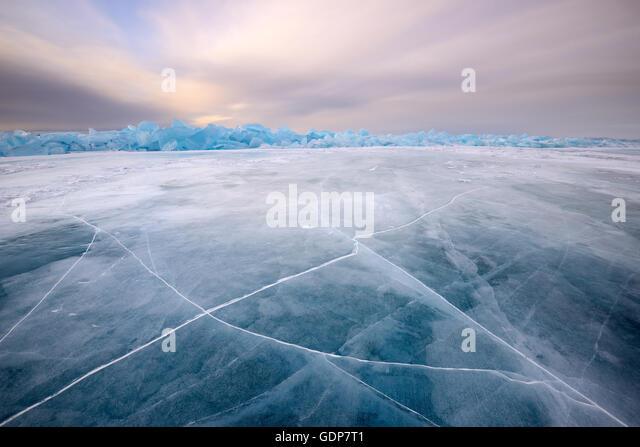 Cracked patterned ice, Baikal Lake, Olkhon Island, Siberia, Russia - Stock Image