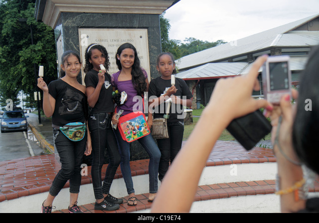 Panama City Panama Amador Panama Canal Hispanic girl teen student friend eating popsicle pose for picture - Stock Image
