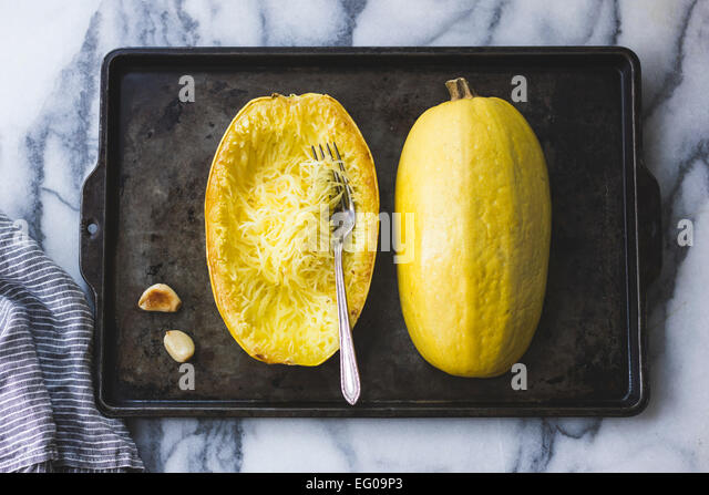 Spaghetti Squash on a baking tray - Stock Image