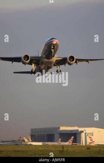 American Airlines Boeing 777 taking off from runway 27R at London Heathrow Airport, UK - Stock Image