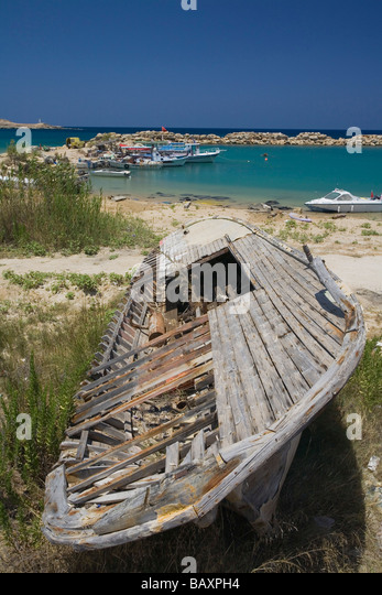 Wreckage of a boat, small fishing port with fishing boats, Erenkoy, Gialousa, Dipkarpaz, Rizokarpaso, Karpasia, - Stock Image