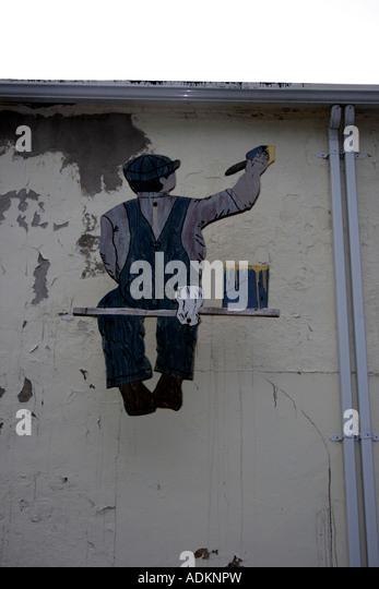 painted painter on facade of building. Photo by Willy Matheisl - Stock Image