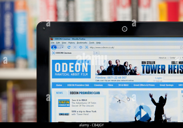 The Odeon website shot against a bookcase background (Editorial use only: print, TV, e-book and editorial - Stock Image