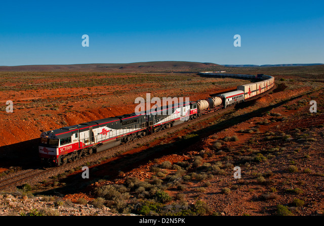 Train travelling through the Outback of South Australia, Australia, Pacific - Stock Image