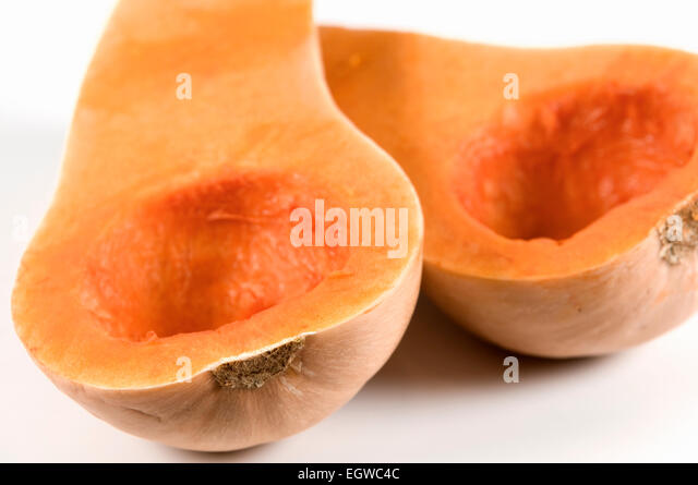 Butternut squash cut in half and deseeded on white background - Stock Image